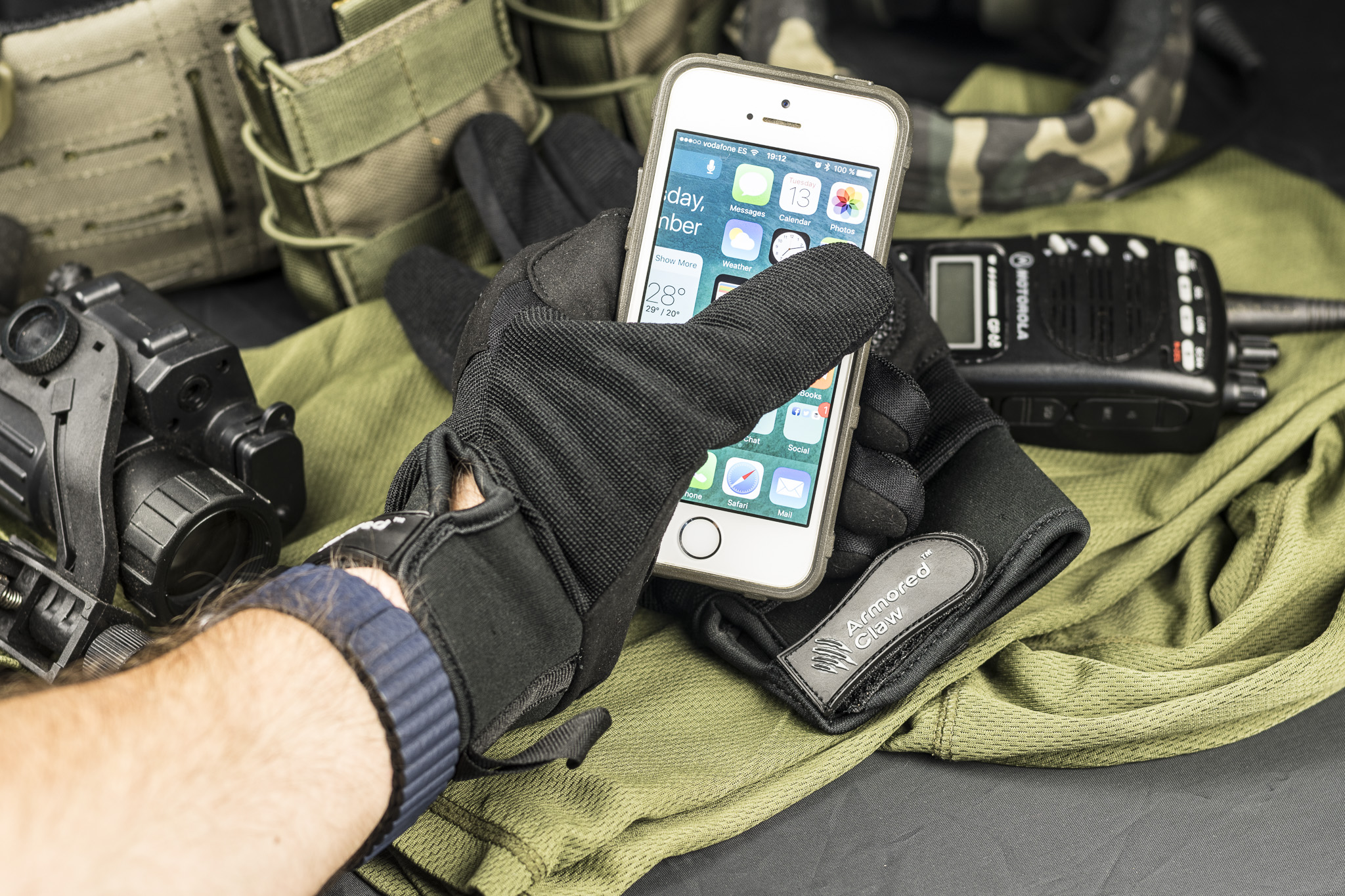 Armored Claw Shield gloves with a smartphone